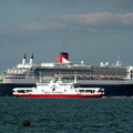Queen Mary 2 and Red Falcon at Cowes
