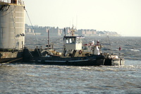 Tug Vigour and Aestus with Skyline barge